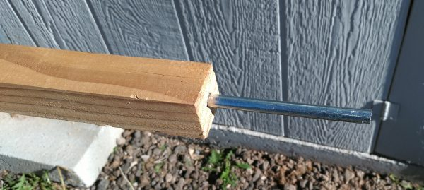 The 2x2, with a smooth length of metal rod fixed firmly into the end.