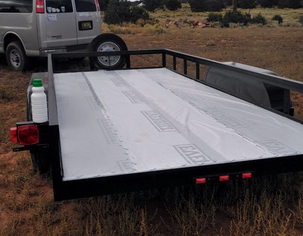 The trailer from a slightly different angle, with the entire bed now covered in housewrap.
