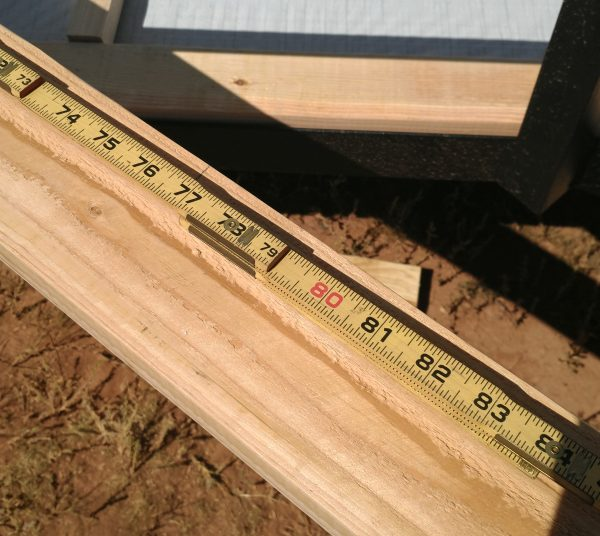 A length of 2x4 with my folding ruler laying along it.