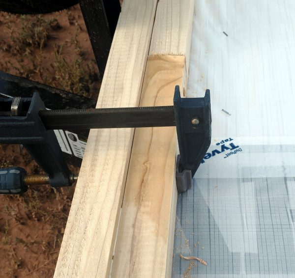 A pair of 2x2s clamped together lengthwise. One is visibly lower than the other.