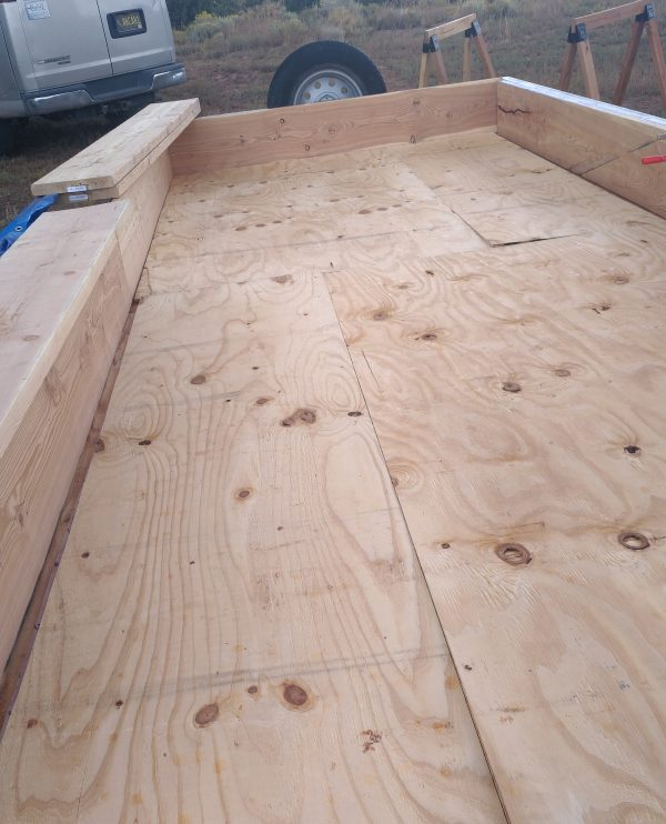 The trailer bed, this time with sheets of plywood covering the bed.