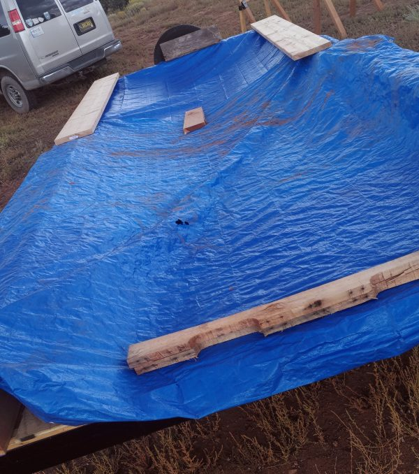 If you guessed that this picture showed the trailer covered in tarps, you are correct! Specifically, they're blue tarps.