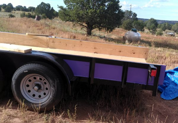 A wide view of the trailer, from the side this time. The purple-painted boards are fastened all around now. It looks kinda pretty good.