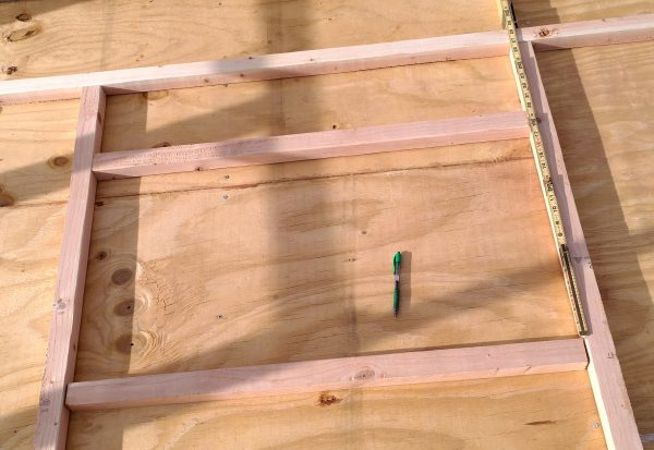 A bunch of 2x2 boards laid out to form a window frame.