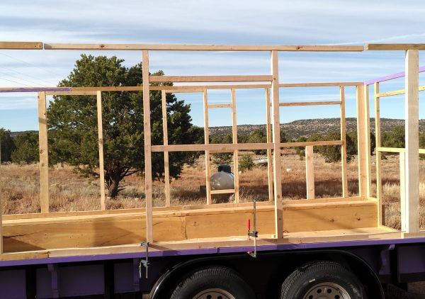 The framed wall in question, now behind held upright in its destined spot on the side of the tinker's wagon with a pair of clamps.