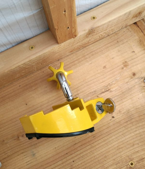 It's ... look, it's bright yellow, is locked with a pair of keys, & has a bent steel rod with a flanged ball on the end.
