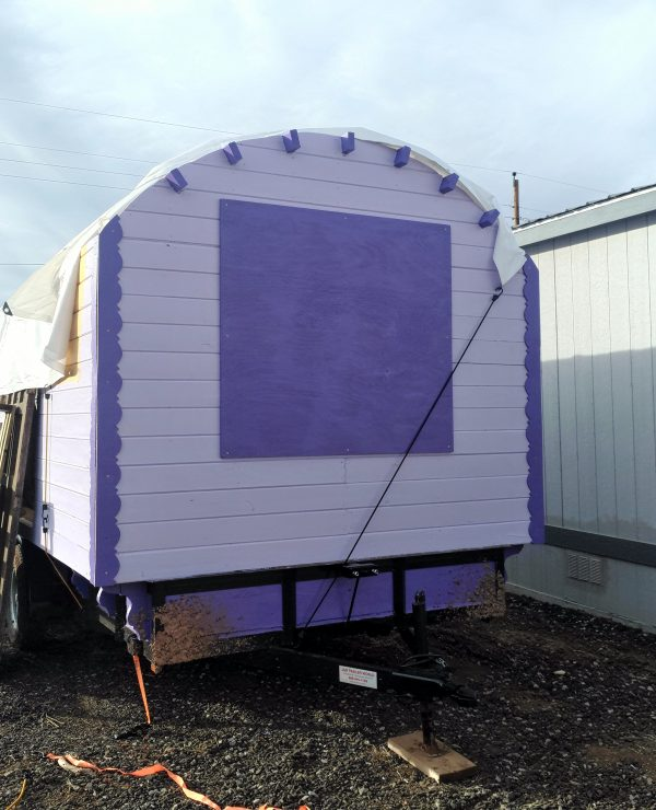 The back wall has purple gingerbread trim covering both corners & yep, that's a big hunk of purple plywood covering the big window.