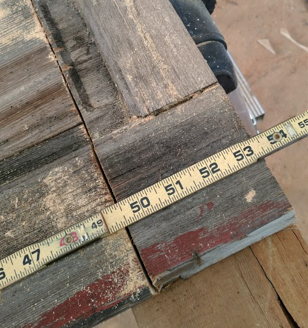 The bottom corner of the door. The ruler's lined up so that it reads 53 1/2 inches right at the bottom of the door.