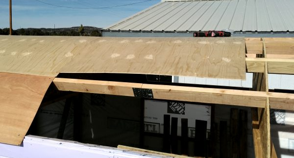 There's another sheet of plywood on the roof of the tinker's wagon. The view is from the side of the wagon, & level with the roof.