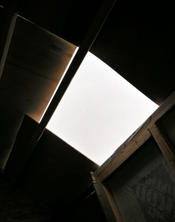 The unfinished section of the roof, seen from the inside. It's maybe two feet wide & a foot and a half high.