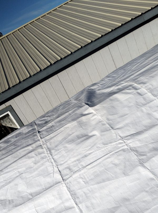 It's a white tarp. It's pretty impossible to tell what it's on top of.