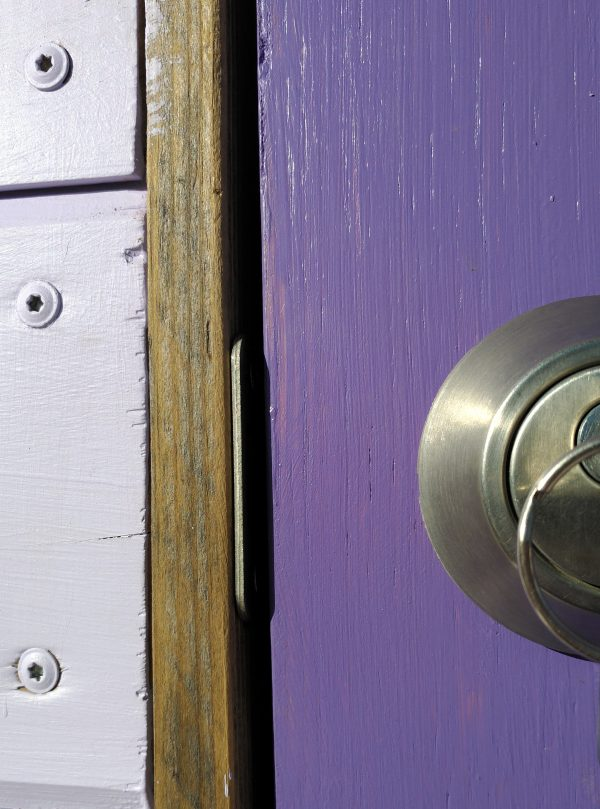 From the outside the silver deadbolt & strike plate look REALLY good against the purple door. If you can ignore the roughly quarter-inch gap between the door & the doorframe, which is supposed to be a LOT smaller than that.