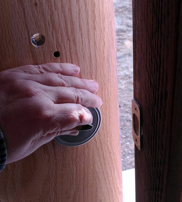 From inside the tinker's wagon again -- my hand is on the deadbolt latch, & the door is slightly open. It's a door!