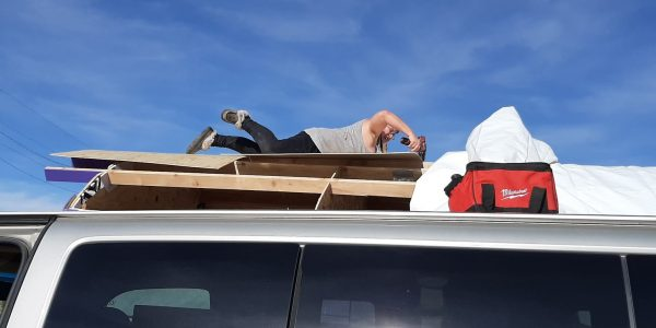 Also from the ground: I'm laying on my belly on top of the tinker's wagon. I'm on top of a sheet of plywood, not just the rafters, because I am not ENTIRELY foolish. I'm wielding a drill.