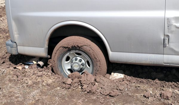 The right rear tire, which is pretty much up to the axle in mud.