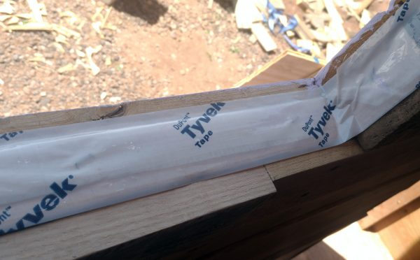 Yep, there's tyvek tape all along the inside edge of the window now.
