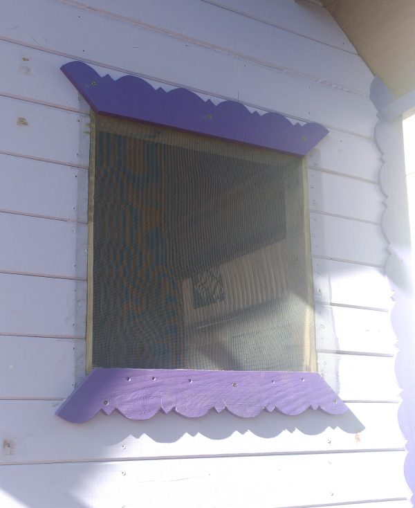 The window now has a second piece of trim fastened along the top edge! The trim covers the edges of the screen nicely.