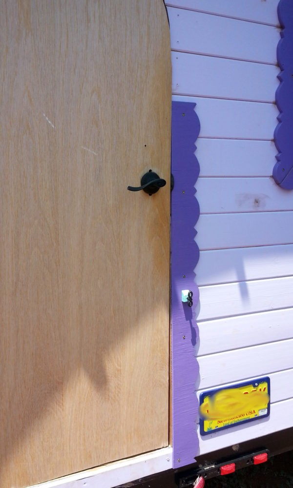 Tyrava's arched front door now has about four feet of simple purple trim running up the right side.