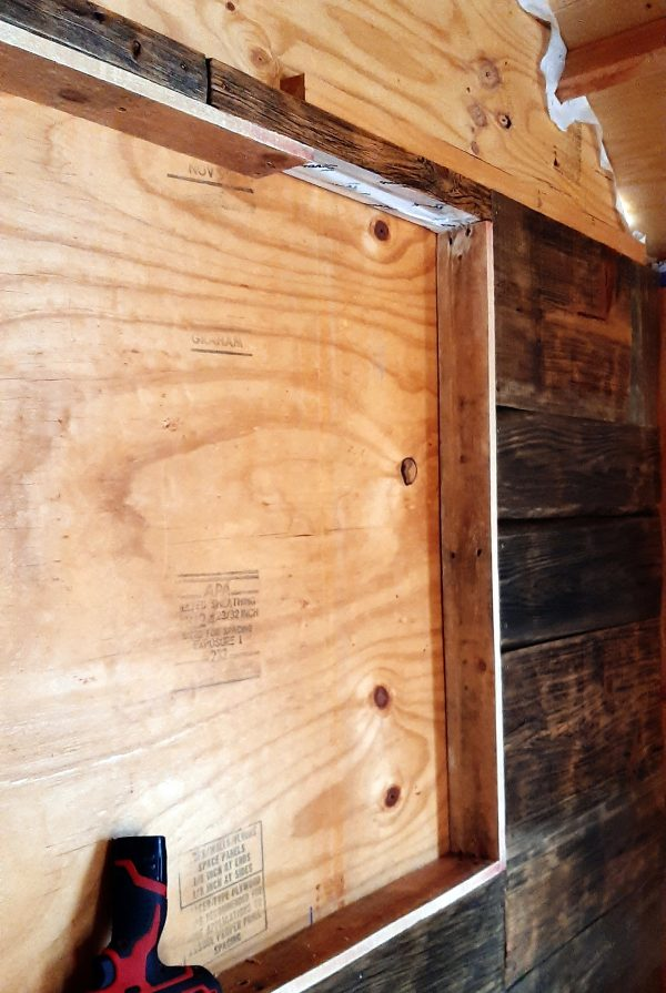 The picture shows the right half of the window -- most of the inside edge of the frame is now covered by pallet wood, except for about a foot on the top edge.
