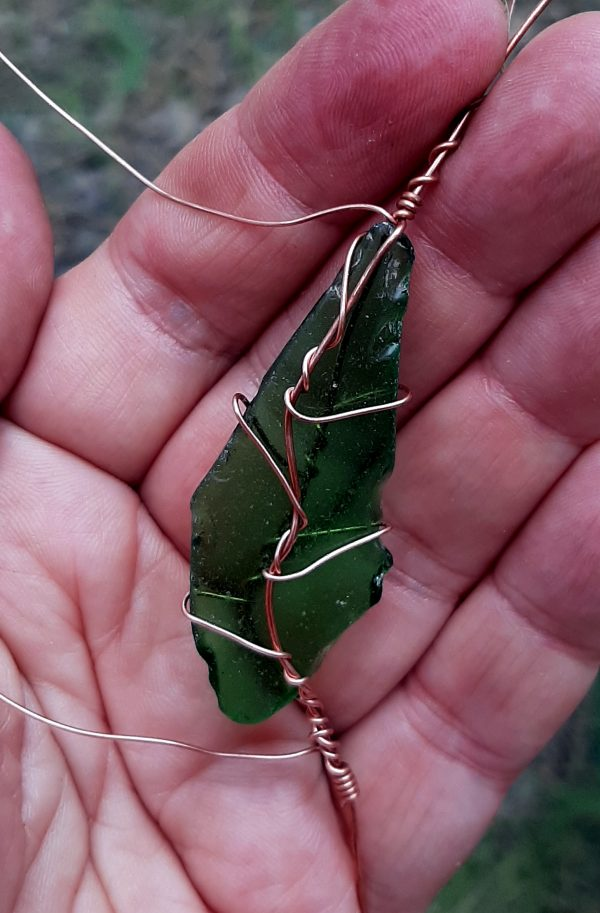 Another sea glass leaf! The thicker copper wire runs up the center of the leaf, & the thinner one runs from the center one out to the edge & then around to the back in several places, angling upwards the way veins do on a leaf.