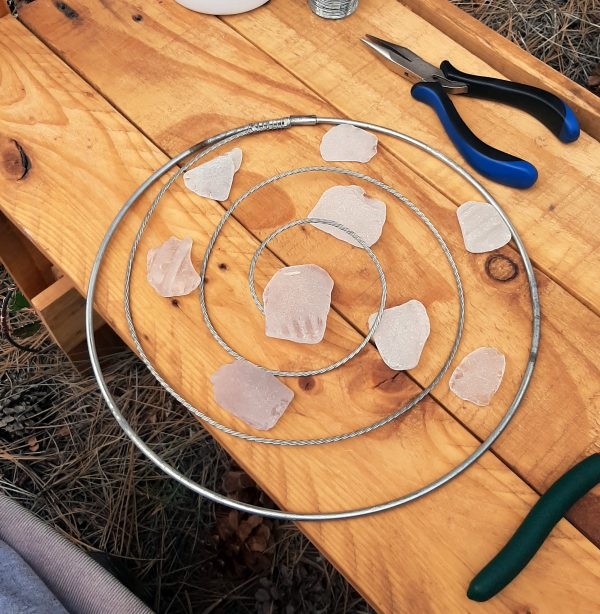 The pieces of seaglass have been arranged around the spiral, reasonably evenly, from small to large, with the biggest one sitting in the center of the spiral.