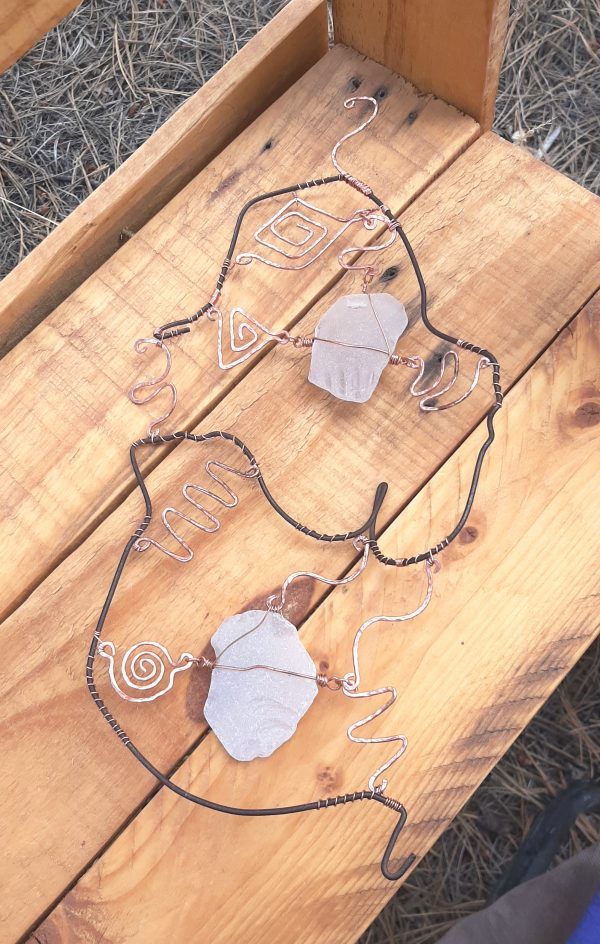 It's done! All of the copper pieces are attached to the clothes hanger wire & to each other or to the two seaglass pieces by thinner copper wire that spirals around the the clothes hanger wire.